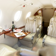 Beechcraft Premier 1a interior with catering of Exxaero private jet for six persons