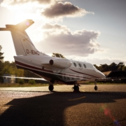 Beechcraft Premier 1a of Exxaero private jet for six persons with sunset